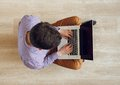 Top view of man sitting on the floor and working with a laptop young Royalty Free Stock Photos