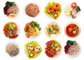 Top view of many plates with food over white background Royalty Free Stock Photo