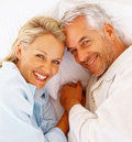Top view of a mature couple in bed Stock Photos