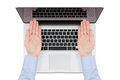 Top view of modern retina laptop with a man's hands directed tow Royalty Free Stock Photo