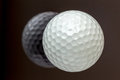 Top view the new white golf ball with the reflection, sport conc Royalty Free Stock Photo