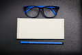 Top view note paper with blue eye glasses and blue pen Royalty Free Stock Photo