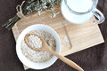 Top view of oatmeal for brakfast breakfast on wooden tray put on brown fabric background Royalty Free Stock Images