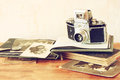 Top view of old camera, antique photographs. Royalty Free Stock Photo