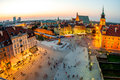 Top view of the old town in warsaw royal castle and crowded with people on evening Royalty Free Stock Photo