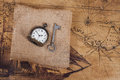 Top view of old vintage pocket watch on burlap Royalty Free Stock Photo