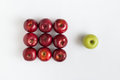 Top view of one green apple among red apples Royalty Free Stock Photo
