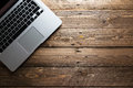 Top view of open laptop ready to work standing on the wooden tab Royalty Free Stock Photo