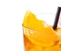 Top of view of orange slice on top of the yellow cocktail with ice cubes and straw on white background Royalty Free Stock Photo