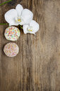 Top view of orchids and muffins on wooden table blank space board Royalty Free Stock Image