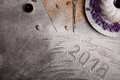 A vanilla cake with flowers on a plate. A New Year composition on a gray background. The inscription 2018 on a desk. Royalty Free Stock Photo