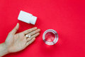 Top view pills on hand with pill bottle and water on red background.Take a medicine concept.