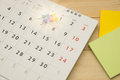Top view. pin putting on desktop calendar and have post-it note Royalty Free Stock Photo