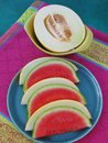 Top view of poolside party table with fresh, juicy melon served on retro ceramics Royalty Free Stock Photo