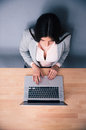 Top view portrait of a woman using laptop on the wooden table Stock Photos