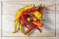 Top view on preserved pickled chilli peppers on a chopping board wooden Royalty Free Stock Image