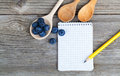 Top view of recipe book with fresh blueberries ingredients on wooden table Royalty Free Stock Photography