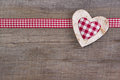 Top view of red checked heart decoration on wooden background country style Royalty Free Stock Images