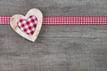 Top view of red checked heart decoration on wooden background country style Royalty Free Stock Photo