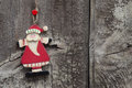 Top view of red Santa Claus decoration on wooden background Royalty Free Stock Photo