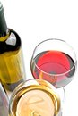 Top of view of red and white wine glasses near wine bottle Royalty Free Stock Photo