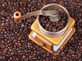 Top view of retro manual coffee grinder on many roasted beans Stock Photo