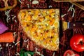 Top view reversed photo of delicious sweet and spicy pizza slice with pineapple, mango, hot sausage and mozzarella cheese