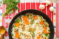 Top view of rice with chicken and vegetables in skillet Royalty Free Stock Photo