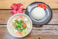 Top view rice on dish with asia soup and red flower at old wood table Royalty Free Stock Photography