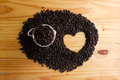 Top view of roasted coffee bean with heart shape space