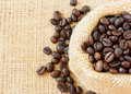 Top view roasted coffee beans jute bag copyspace left Royalty Free Stock Photos