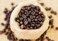 Top view roasted coffee beans jute bag small depth field Stock Image