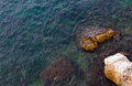 Top view of rocks and clear sea water mediterranean waves Stock Photography