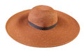 Top view of a round straw hat on a white background. Royalty Free Stock Photo