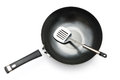 Top view of a saucepan and spatula on white Royalty Free Stock Photography