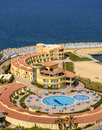 Top view of sea hotel swimming pool empty under sunlight Royalty Free Stock Photo