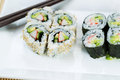 Top view shot of California Rolls in white plate Royalty Free Stock Photo