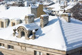 Top view of snow roofs and chimneys. Royalty Free Stock Photo