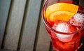 Top of view of spritz aperitif aperol cocktail glass with orange slices and ice cubes on wood table Royalty Free Stock Image