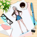 Top view of table with flowers, papers, sketch, pen, envelope and coffee cup. Paper with hand drawn fashion woman.