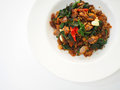 Top view of Thai local traditional food: stir fried crispy duck chopped meat with holy basil Royalty Free Stock Photo