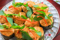Top view Thai steamed curry fish in banana leaf cups decorated with basil leaf, (Hor Mok Pla) Royalty Free Stock Photo