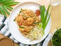 Top view of Thailand traditional style noodles food , stir-fried rice noodles with Shrimp call Pad Thai Goong Sod on white plate w Royalty Free Stock Photo