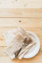 Top view three antique forks and napkin on white plate Royalty Free Stock Photo