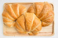 Top view,three croissants on wooden trey. Royalty Free Stock Photo