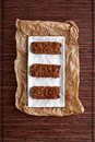 A top view of three raspberry granola bars on the parchment Royalty Free Stock Image
