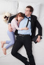 Top view of tired businessman and his little cute photo wearing suit daughter father s arm is over daughter they both sleeping on Stock Image