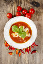 Top view of tomato and pepper soup on wooden table Royalty Free Stock Photo