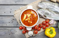 Top view of of tomato soup on wooden table Royalty Free Stock Photo