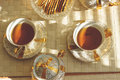 Top view of two cups of tea on wooden table. Toned. Royalty Free Stock Photo